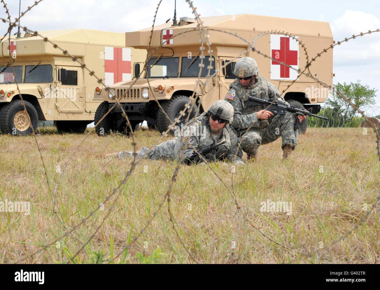 U.S. soldiers set up an effective security perimeter at Fort Riley, Kansas. - Stock Image