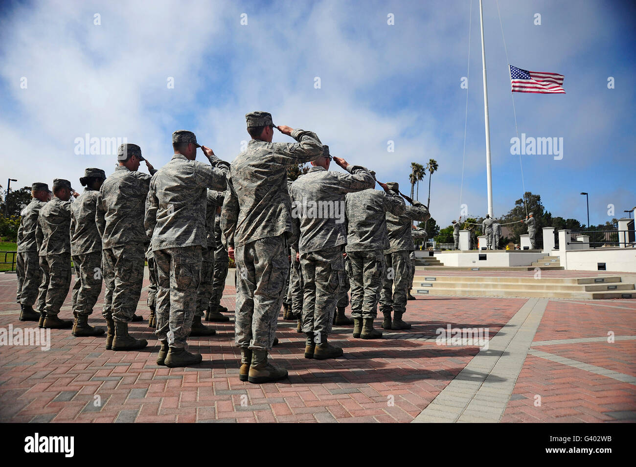 Members of the 30th Space Wing perform a retreat ceremony. - Stock Image