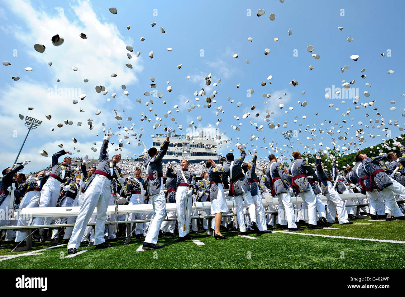 Cadets toss their hats at the end of graduation. - Stock Image