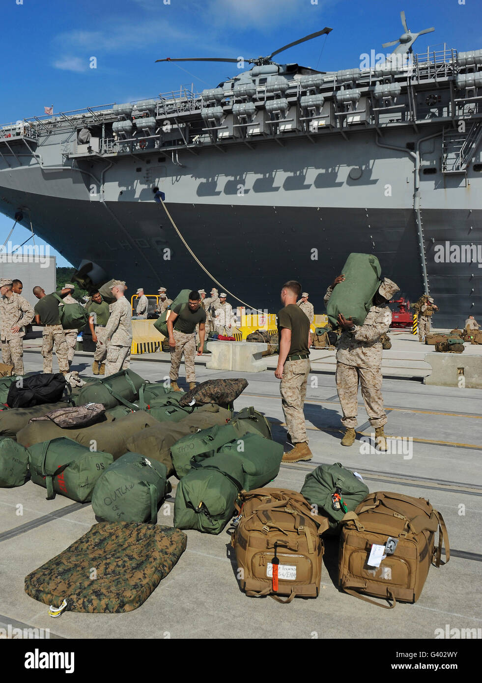 Marines move gear during an embarkation aboard USS Bonhomme Richard. - Stock Image