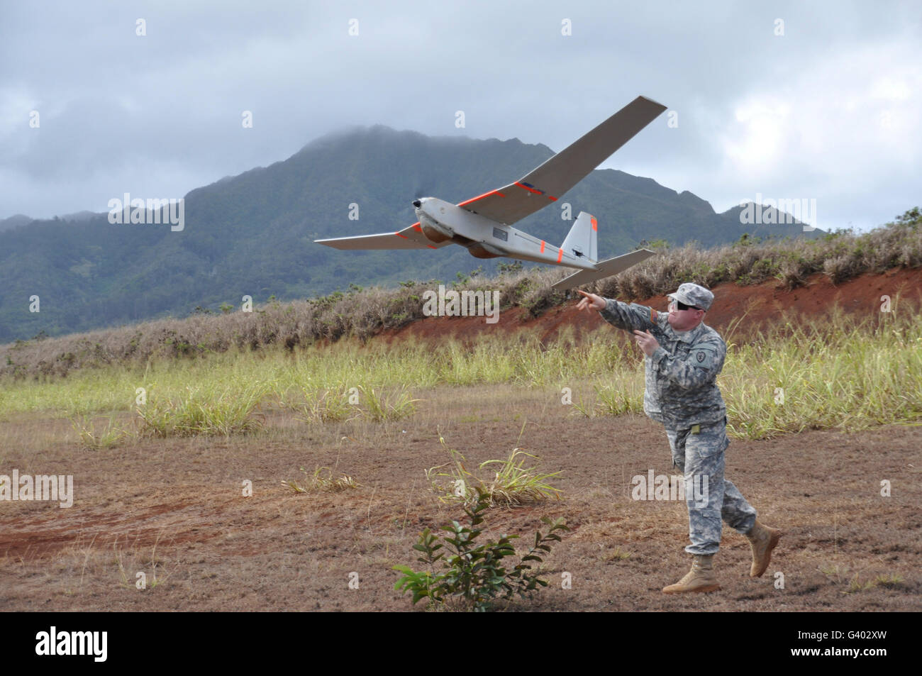 Soldier launches a RQ-20 unmanned aircraft system. - Stock Image