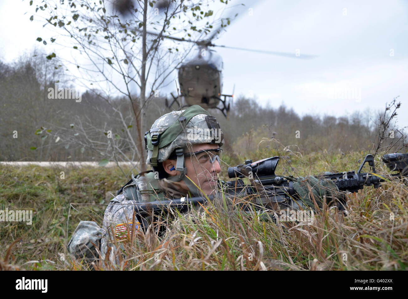 A U.S. Army Soldier pulls security during a situational training exercise. - Stock Image
