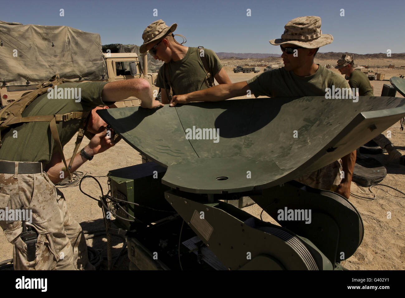 U.S. Marines assemble a support wide area network satellite dish. - Stock Image