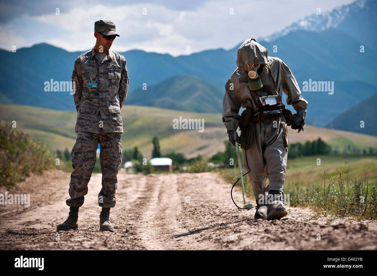 Member of the Kyrgyz Republic searches for contaminated material. - Stock Image