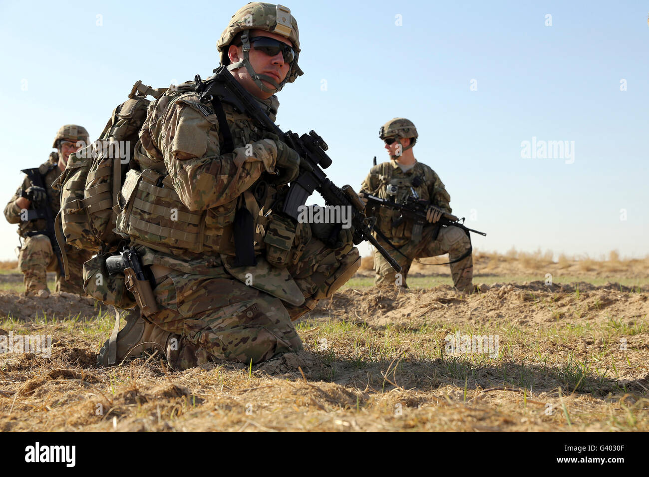Petty officer takes a break with fellow team members. - Stock Image