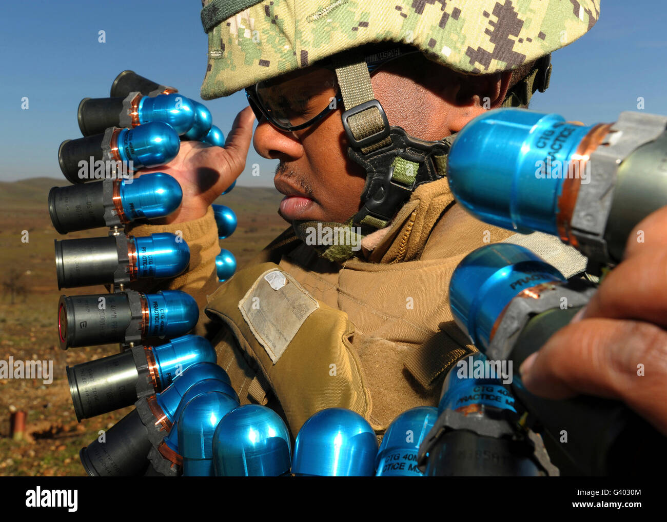 Soldier readies 40mm grenades to fire from the Mk19 grenade launcher. - Stock Image