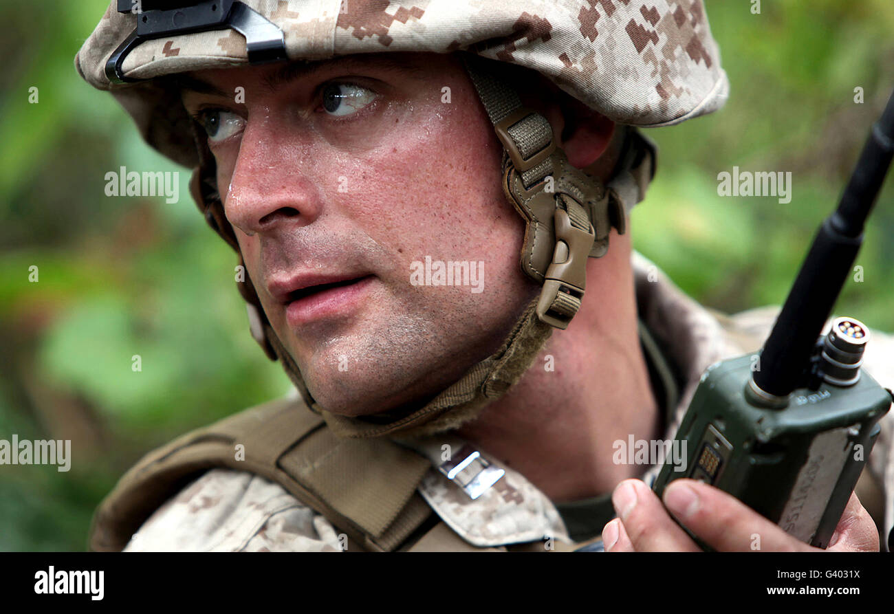 U.S. Marine calls for helicopter support. - Stock Image