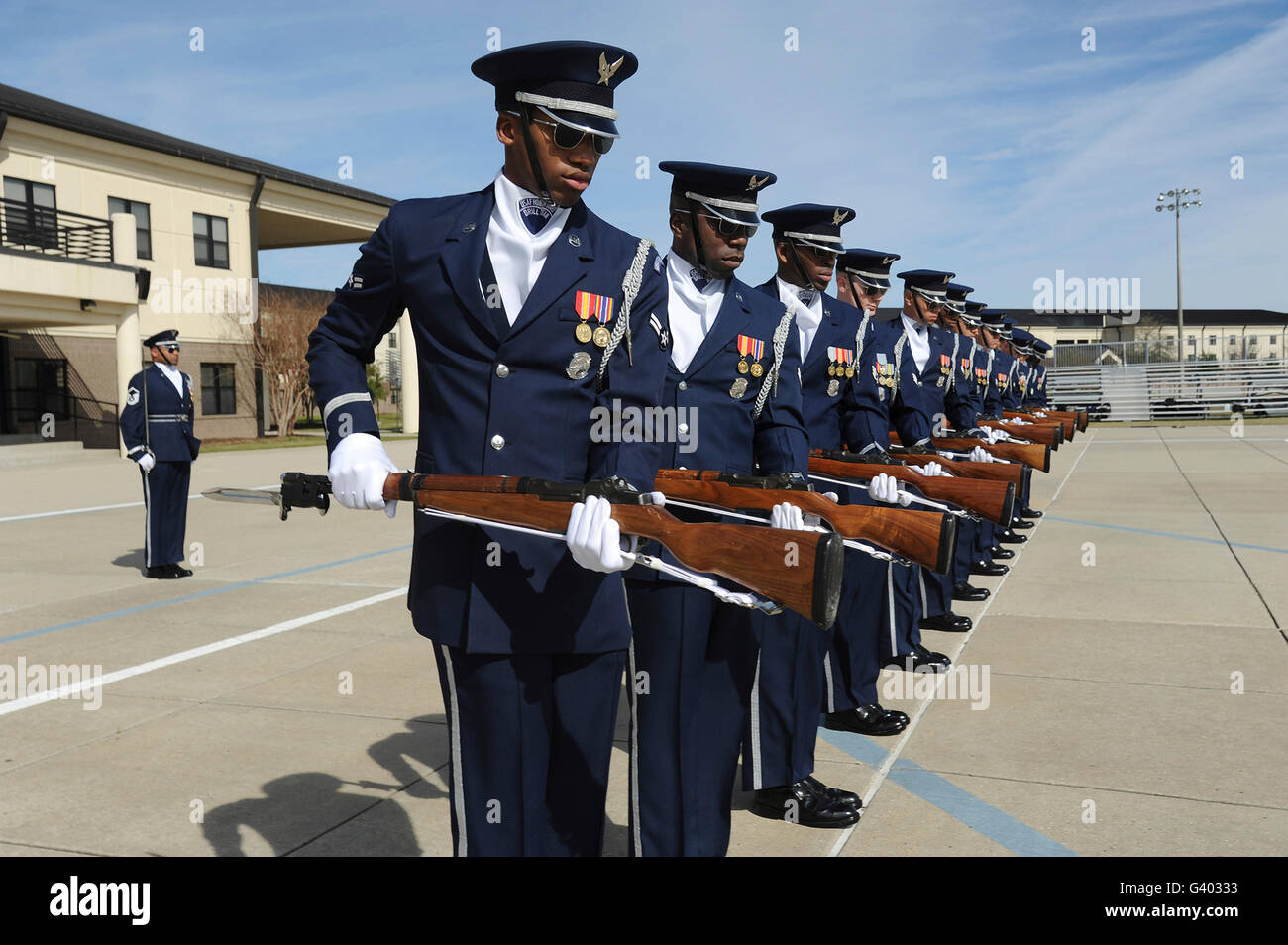 The United States Air Force Honor Guard Drill Team practices a new routine. - Stock Image