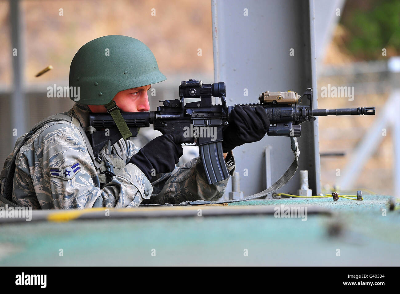 Airman zeroes in his weapon before a shooting exercise. Stock Photo