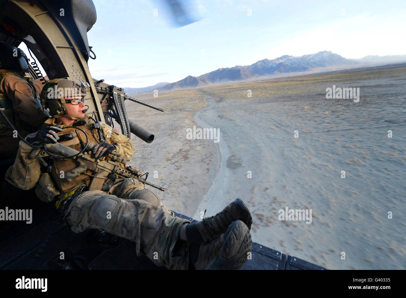 Pararescueman watches the terrain during a training mission in Afghanistan. - Stock Image