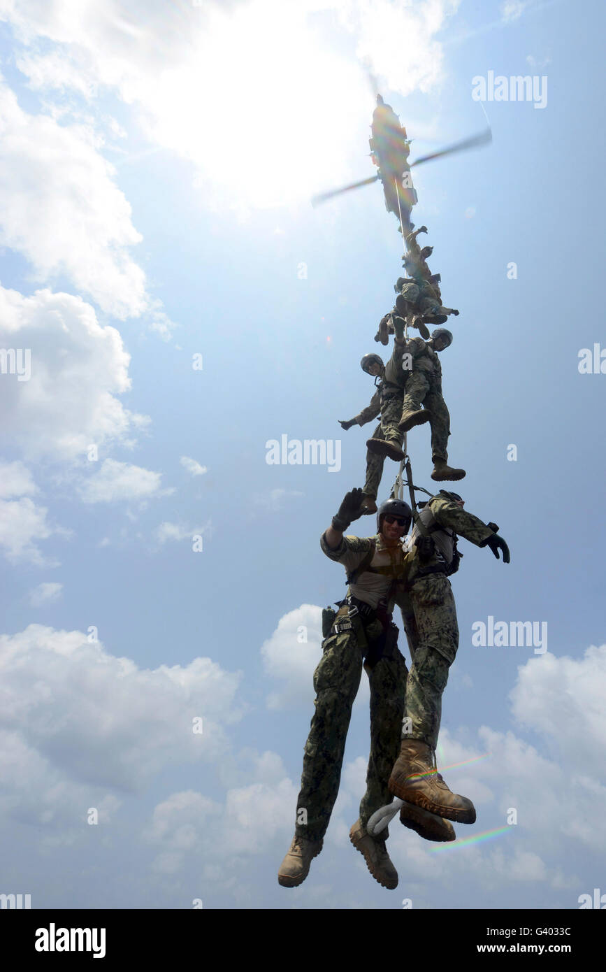 Explosive ordnance disposal technicians participate in spy rope training. - Stock Image