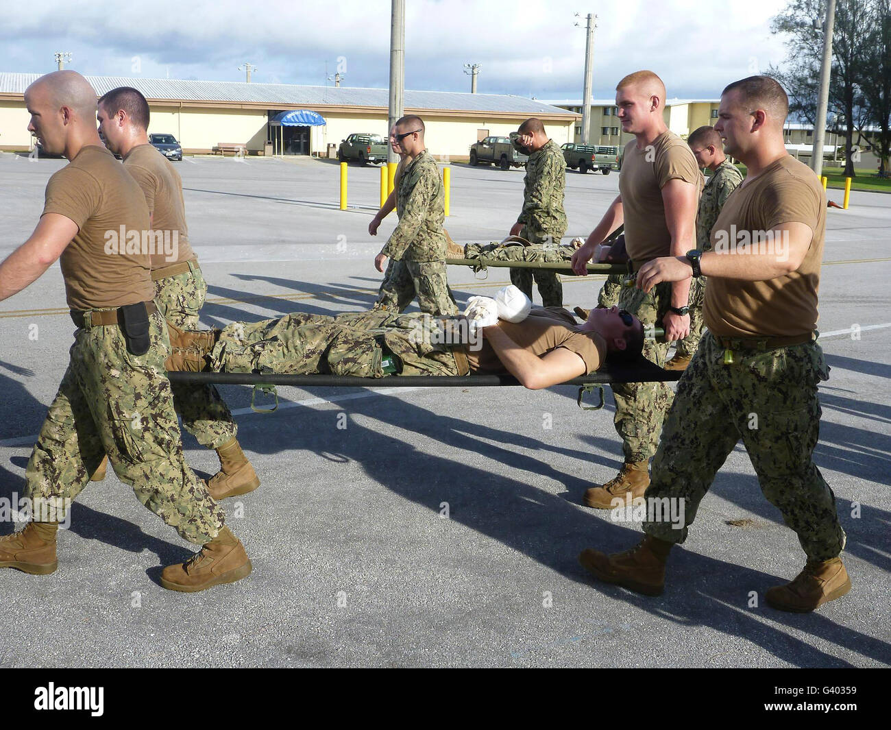 Seabees practice first aid emergency response and litter carrying skills. - Stock Image