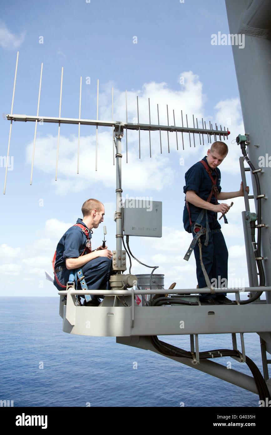 Technicians perform maintenance on the OE-578 antenna. - Stock Image