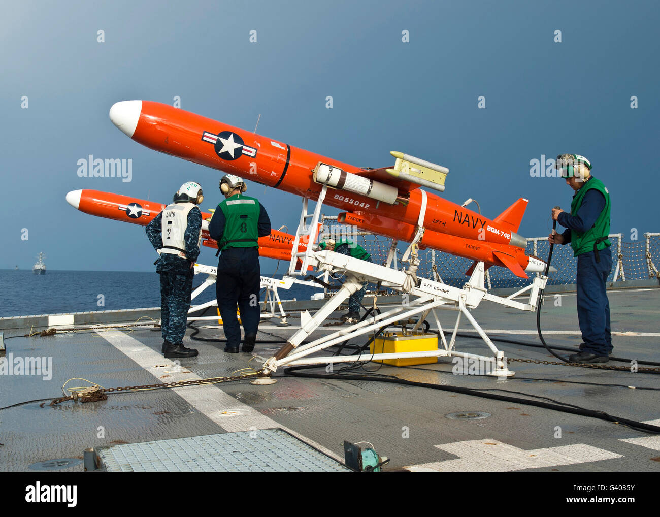 Sailors perform pre-launch checks on a BQM-74 target drone. - Stock Image