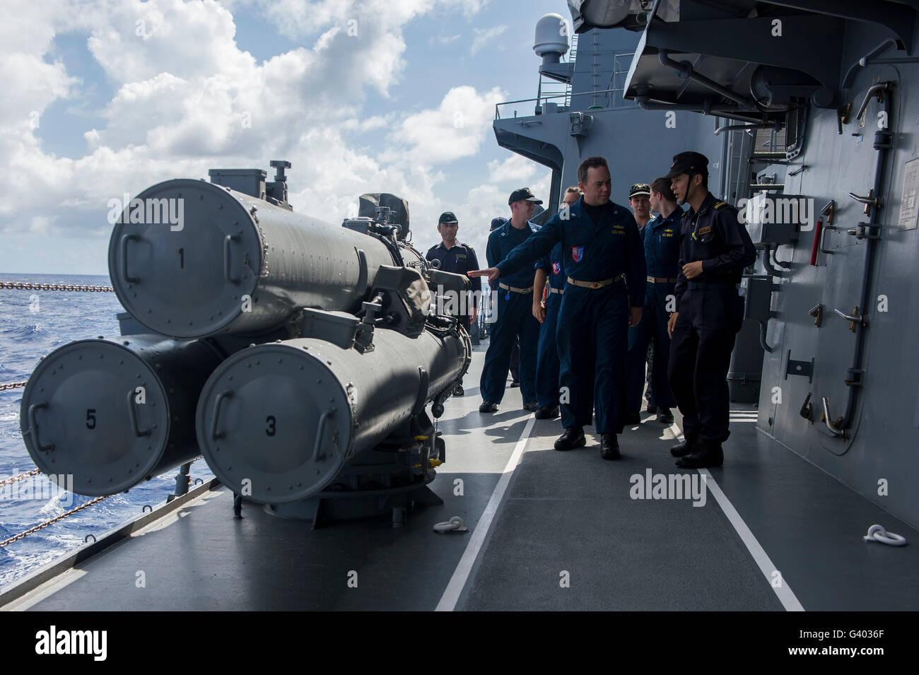 Sailors aboard the Japan Maritime Self Defense Force JS Murasame. - Stock Image