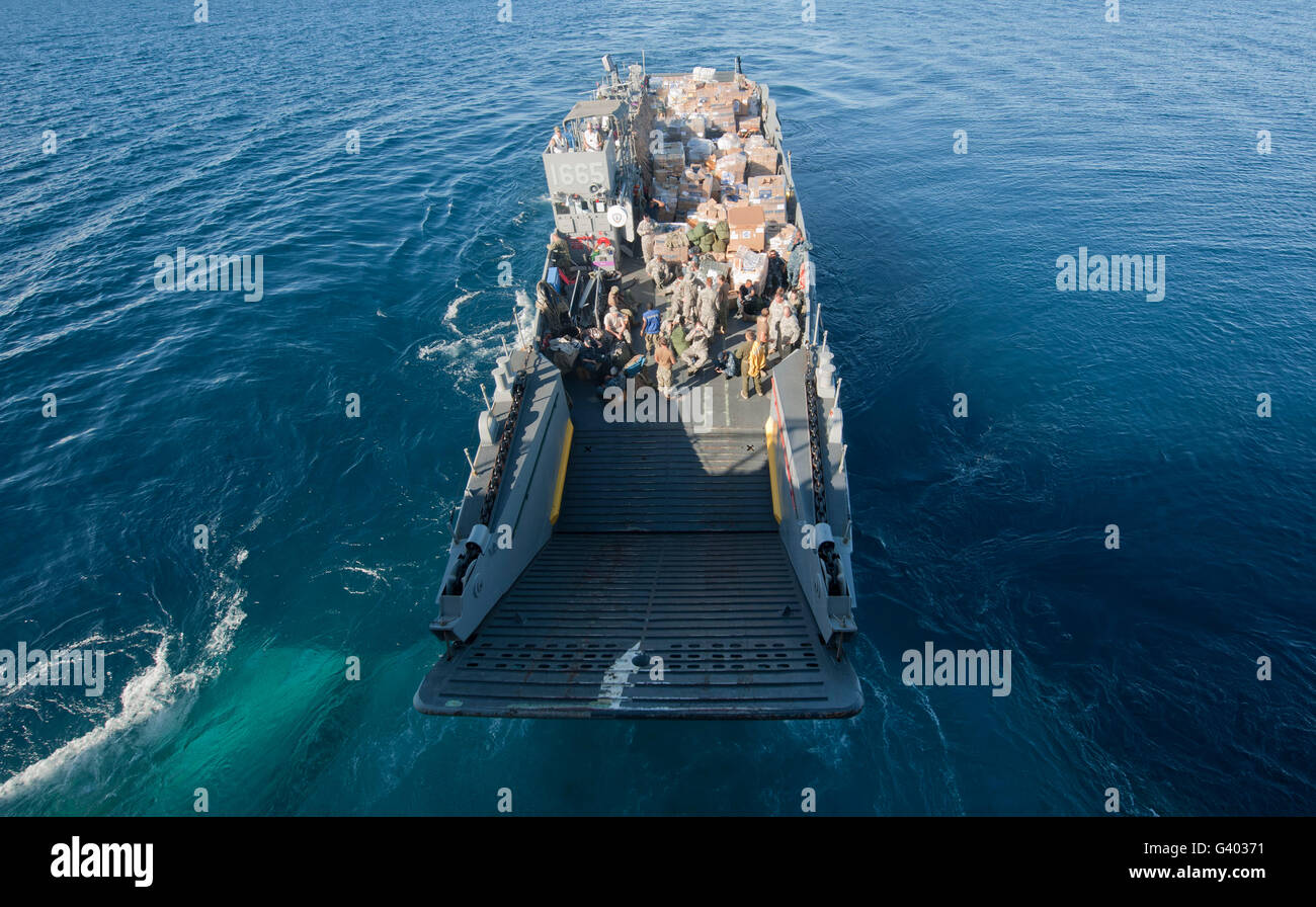 A landing craft utility departs the well deck of USS Pearl Harbor. - Stock Image