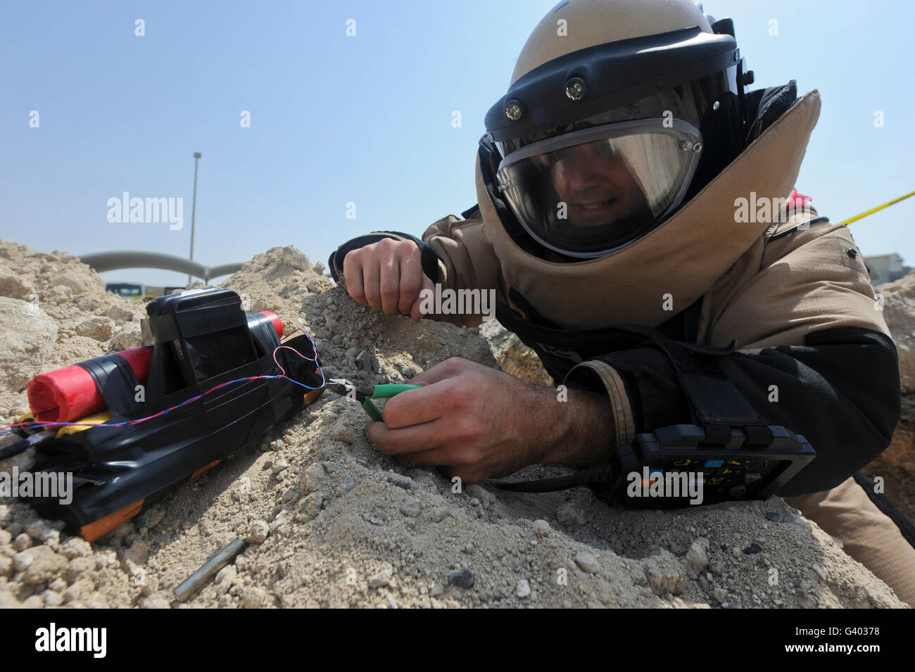 Explosive ordnance disposal technician disables an IED. - Stock Image