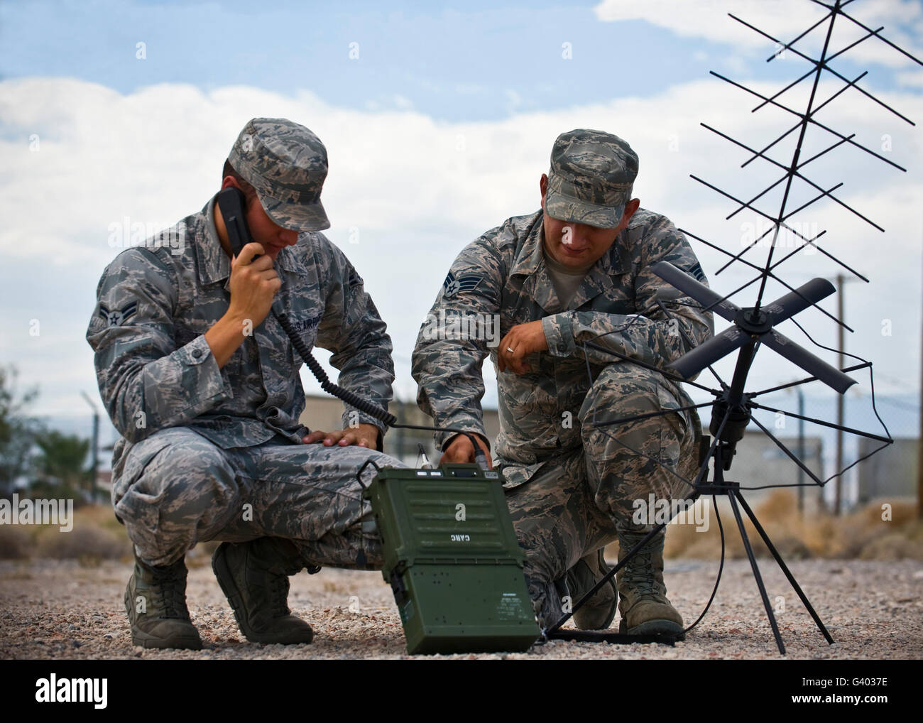 Airmen operate a mobile ground radio satellite system. - Stock Image
