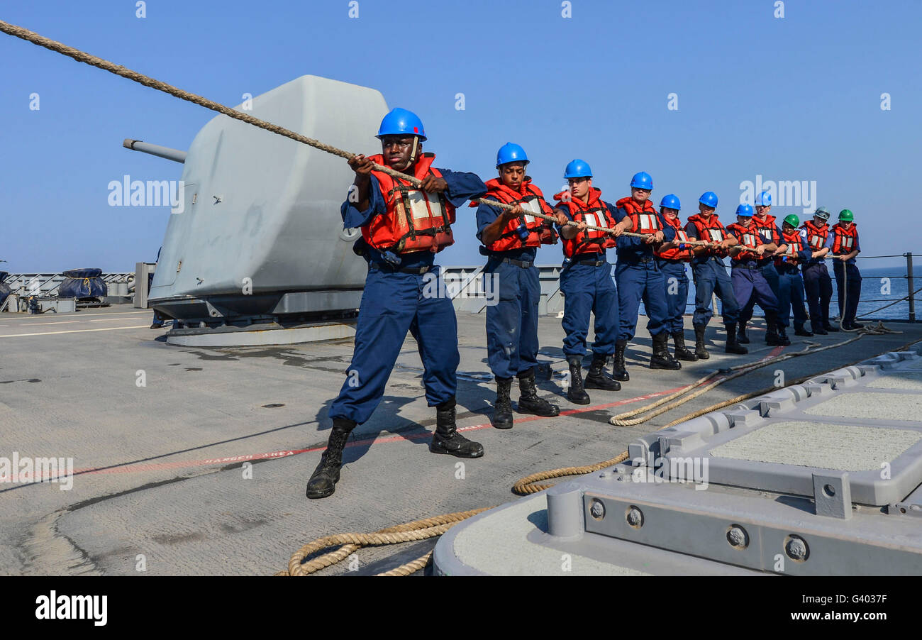 Sailors heave a line during a man overboard drill aboard USS Monterey. - Stock Image