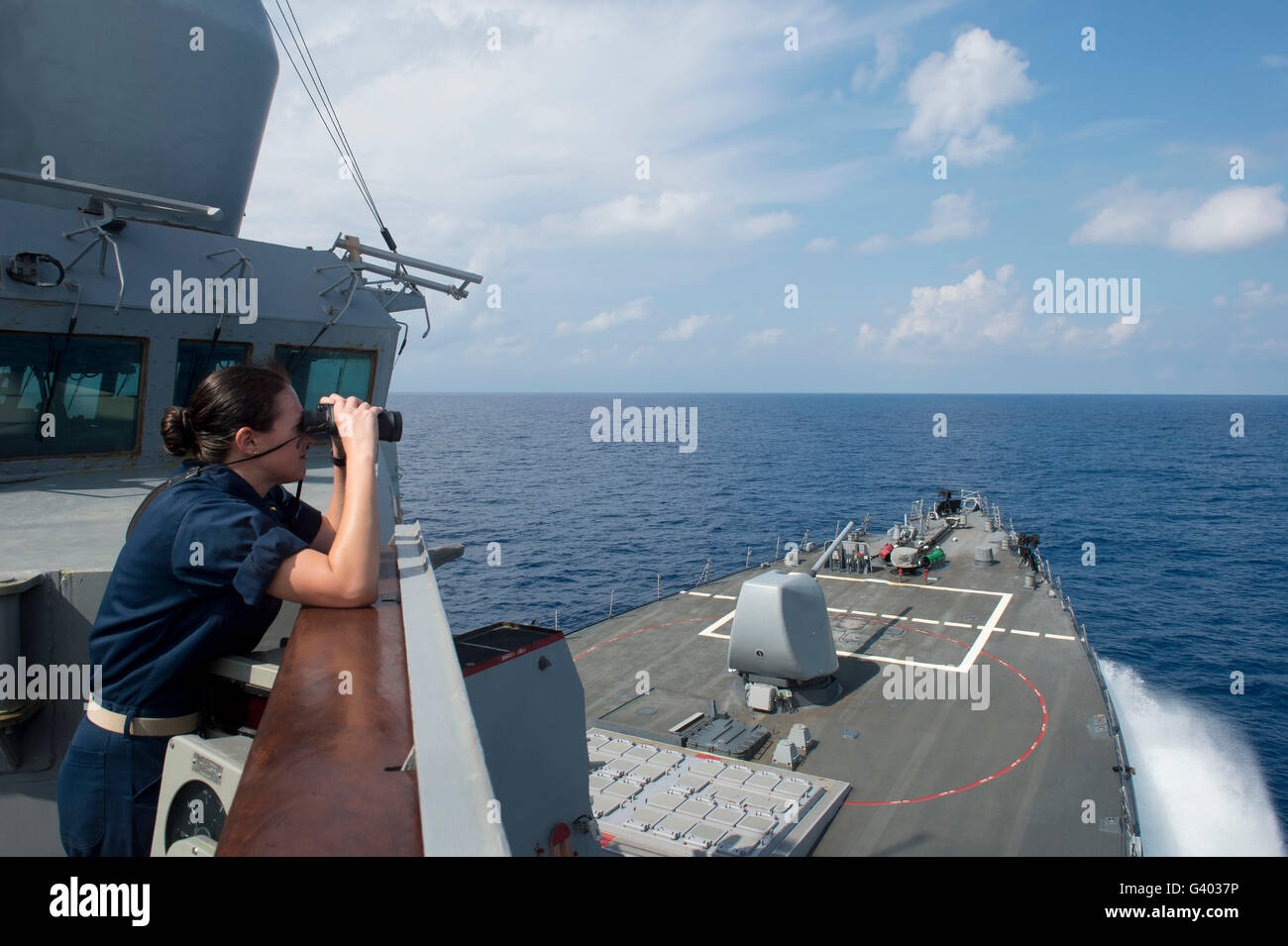 Officer of the deck monitors nearby shipping traffic aboard USS Mahan. - Stock Image