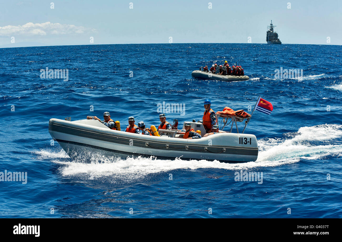 Sailors in ridged-hull inflatable boats during a search a rescue exercise. - Stock Image