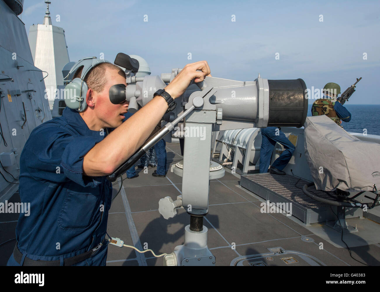 Seaman looks through the Big Eyes aboard USS New Orleans. - Stock Image