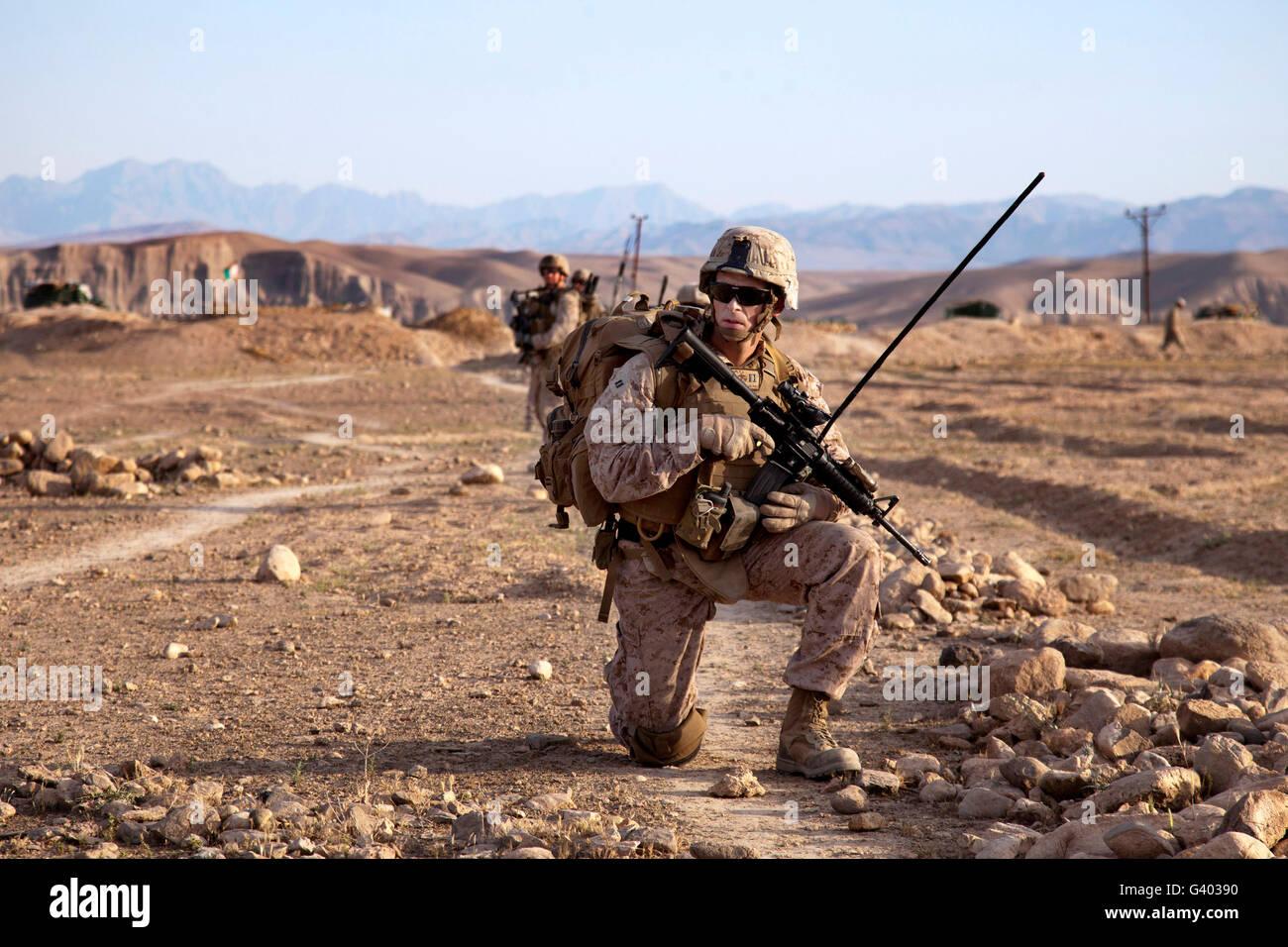 U.S. Marine pauses during a dismounted patrol. - Stock Image