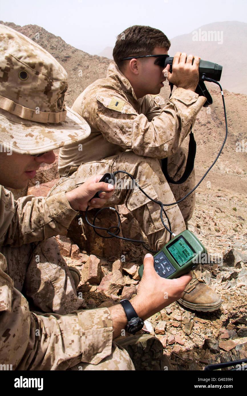 U.S. Marines gauge distances of targets while training. - Stock Image
