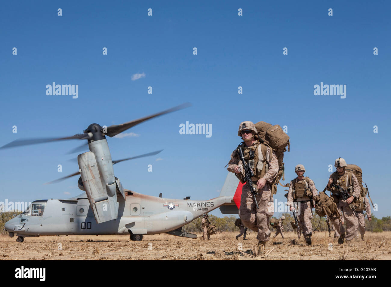 Marines and Sailors offload from a MV-22 Osprey. Stock Photo