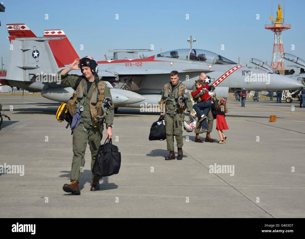 Strike Fighter Squadron officers are greeted by their families at homecoming. - Stock Image