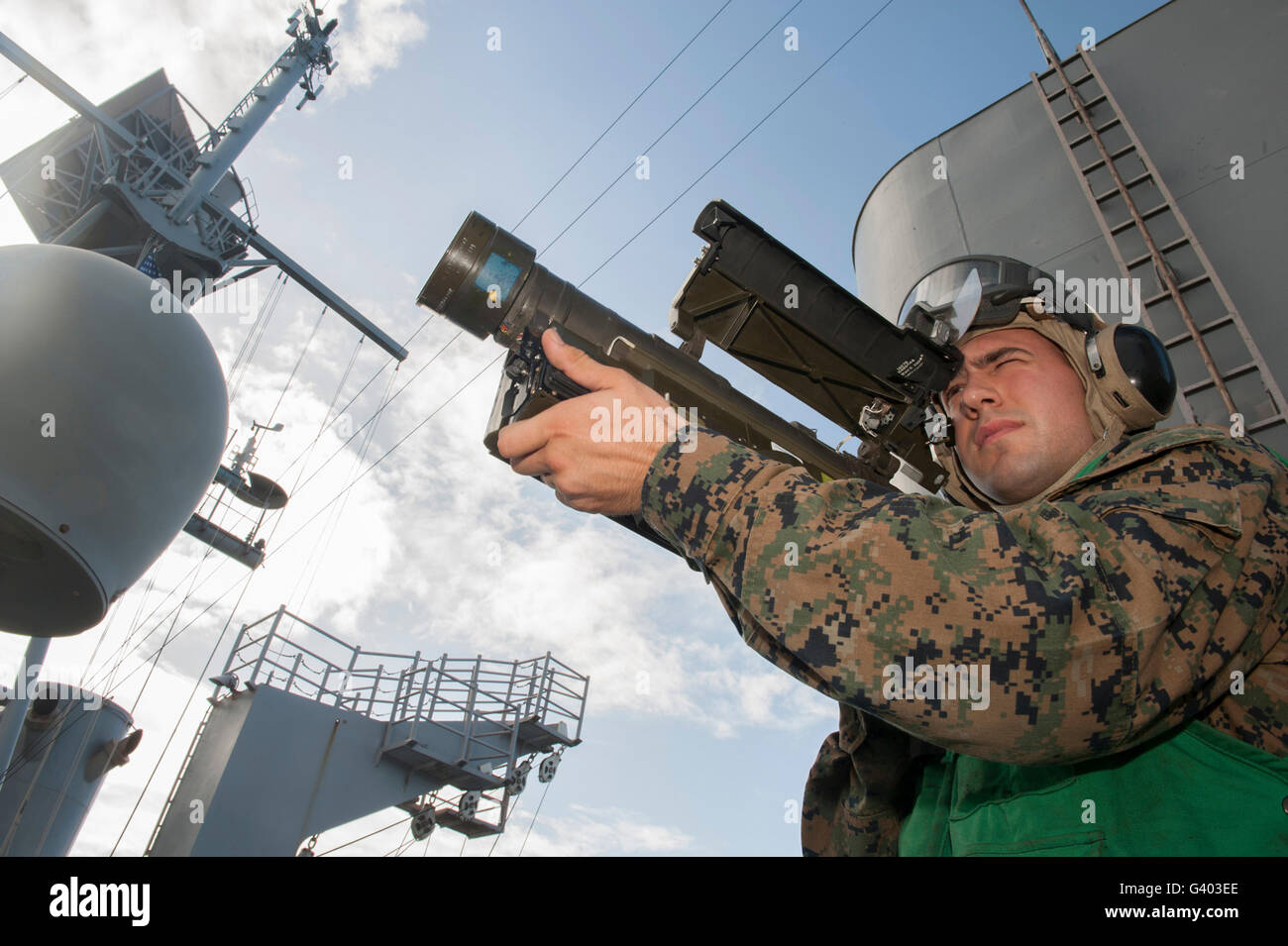 Soldier practices tracking with a trainer version of a Stinger missile launcher. - Stock Image