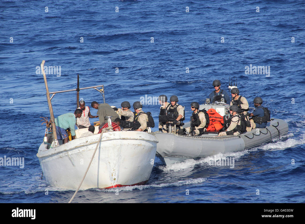 A visit, board, search and seizure team assist stranded Somali fishermen. - Stock Image
