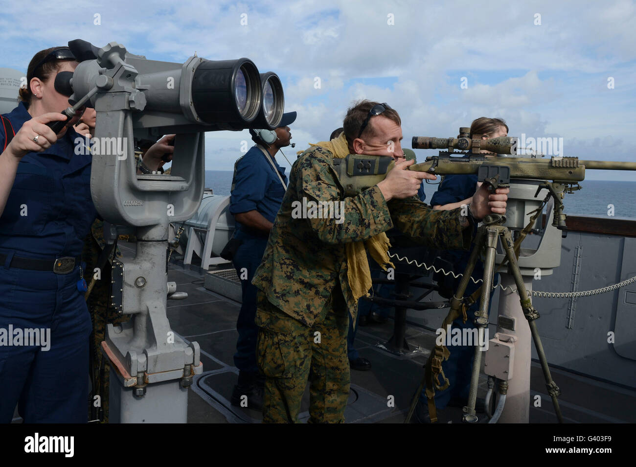 Sailors and Marines participate in a visit, board, search and seizure. - Stock Image