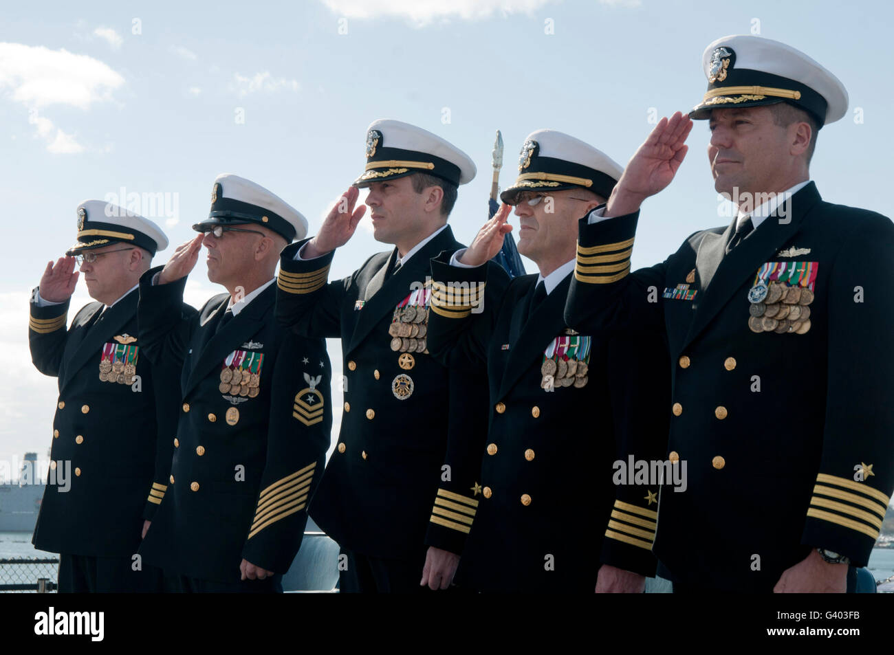 The official party salutes during a change of command ceremony. - Stock Image