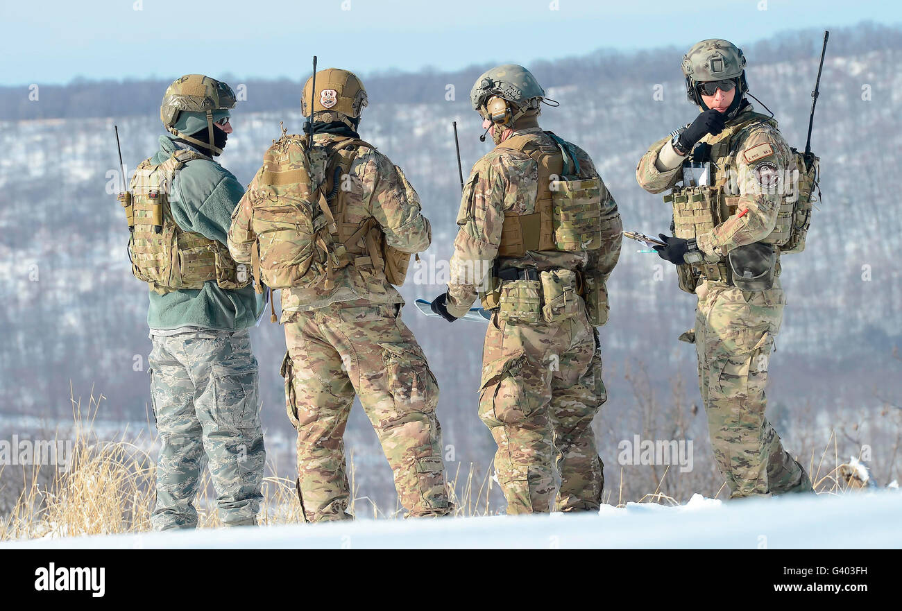Members of the joint terminal attack controller team plot targets. - Stock Image