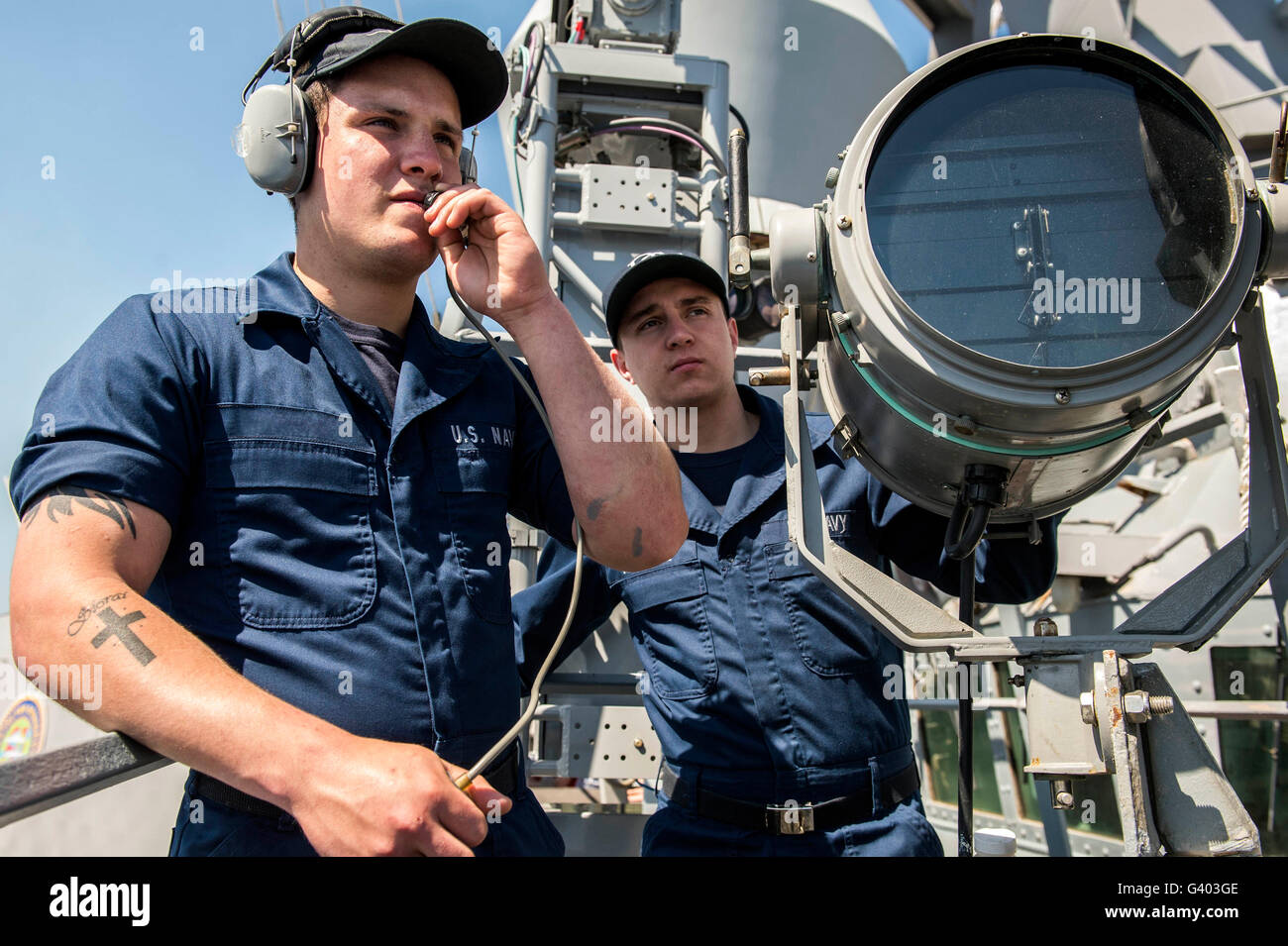 Seamen track surface contacts aboard USS Donald Cook. - Stock Image