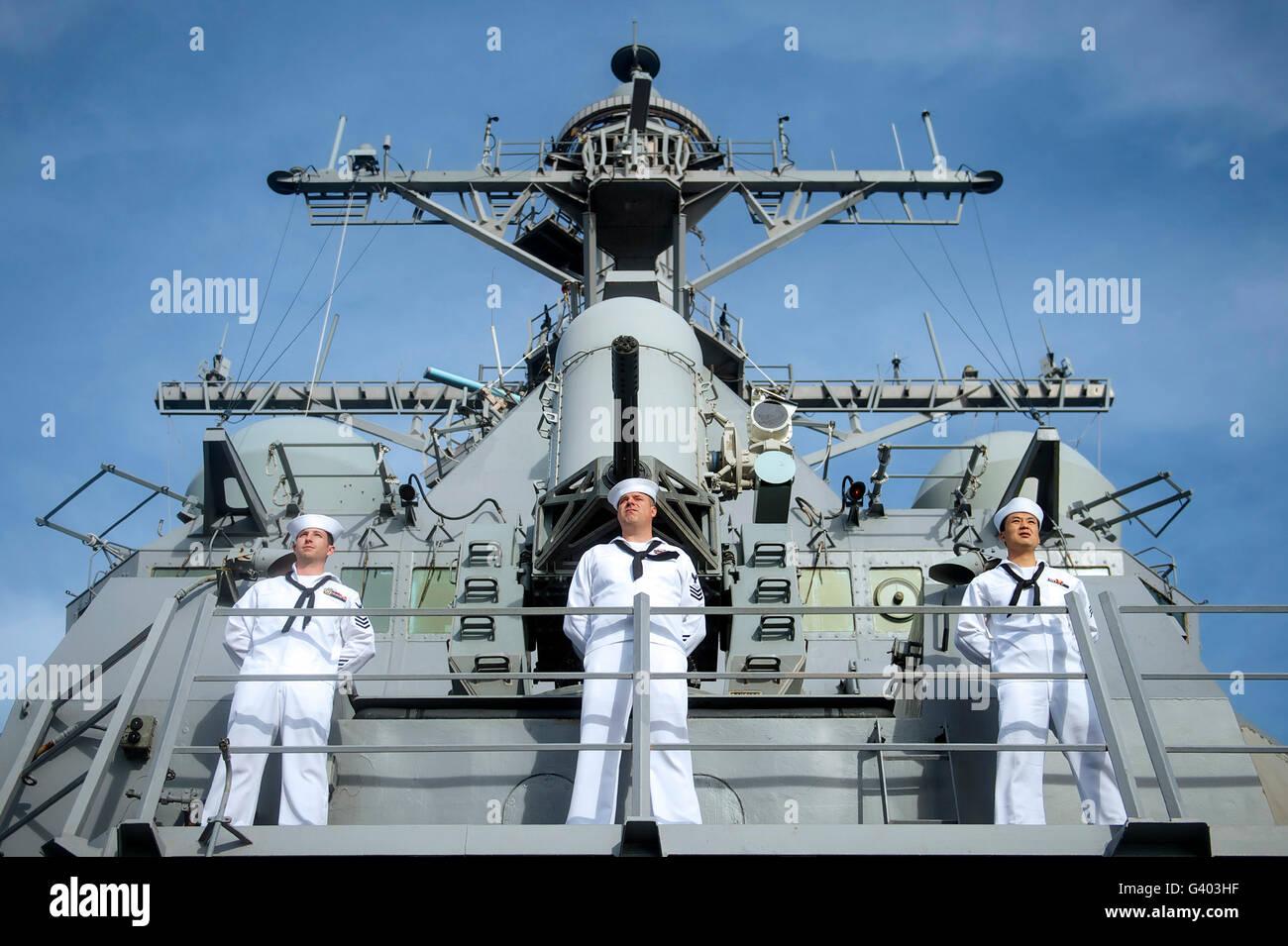 Sailors man the rails aboard USS John S. McCain. - Stock Image