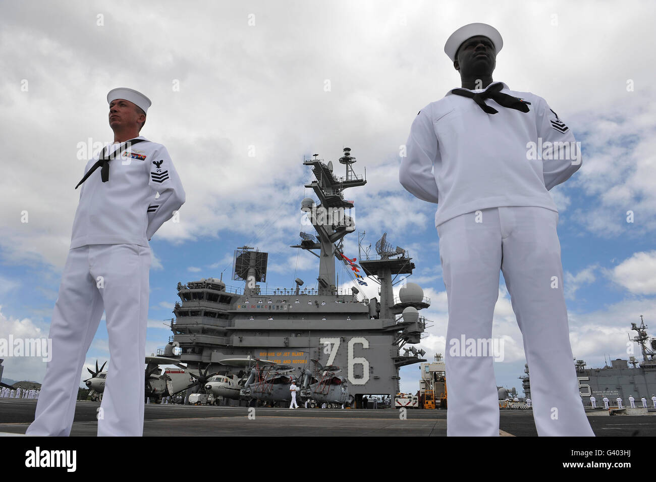 Sailors man the rails aboard USS Ronald Reagan. - Stock Image