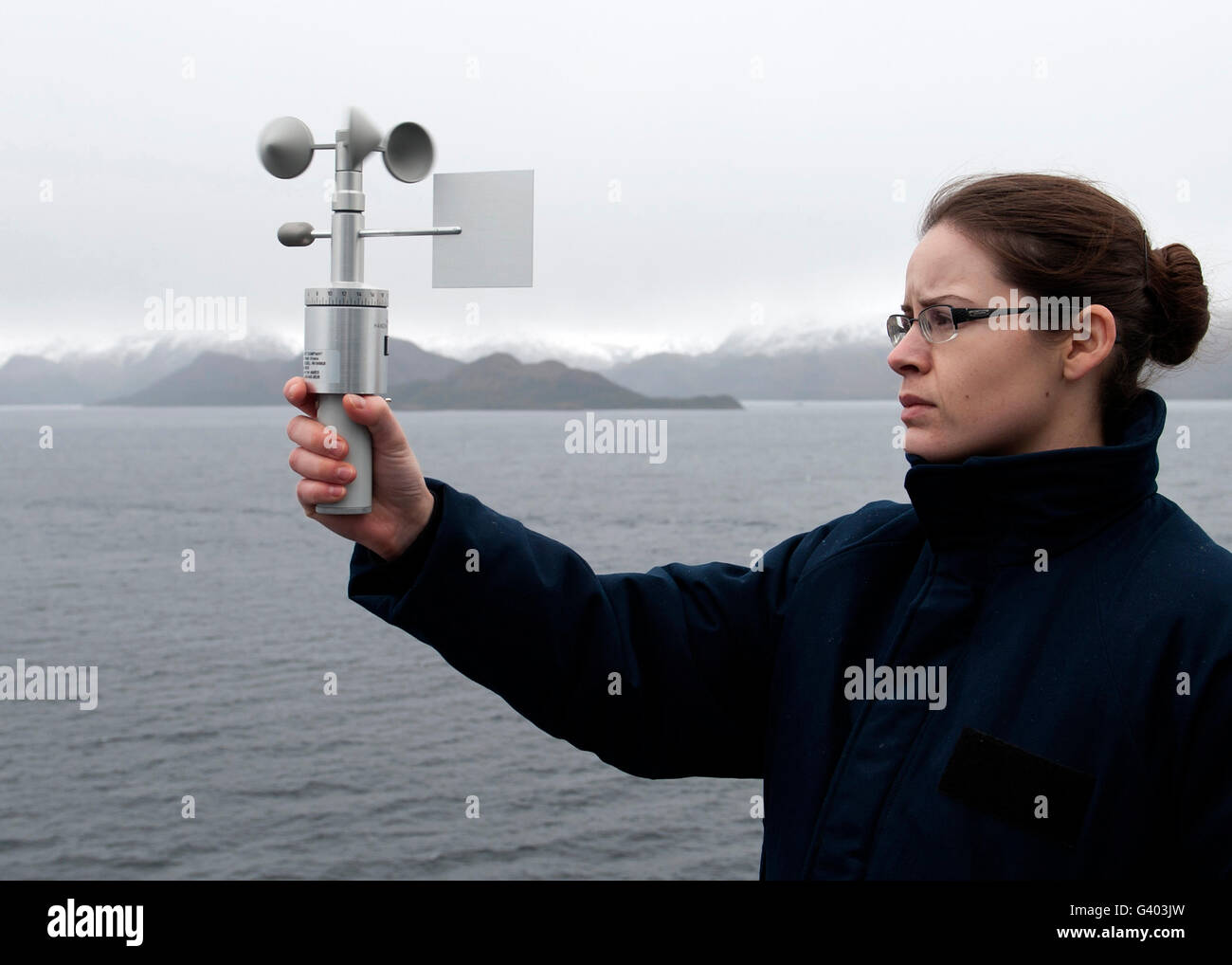 Aerographer's Mate uses an anemometer to measure the wind speed. - Stock Image