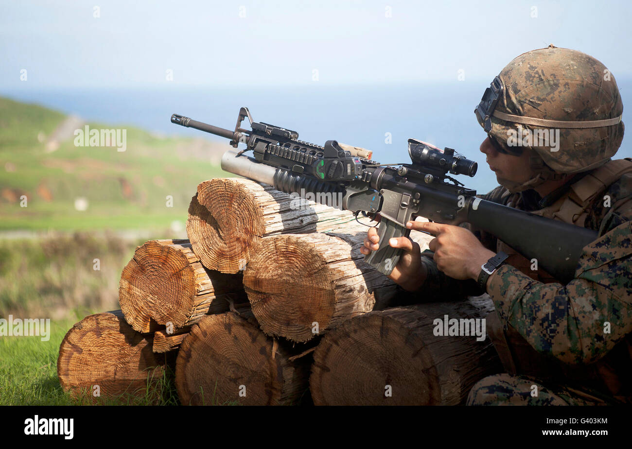 A rifleman shoots an M203 grenade launcher. Stock Photo