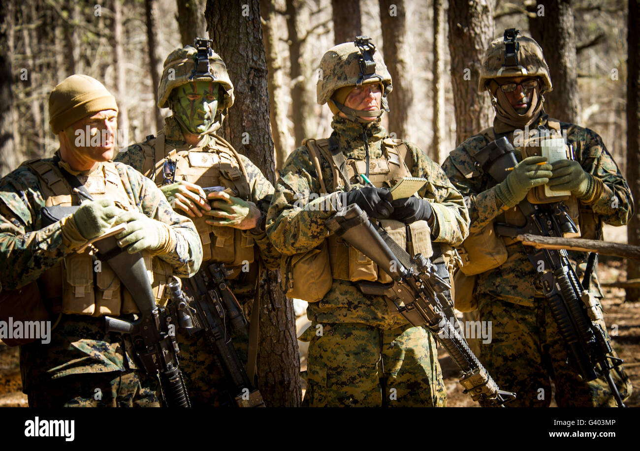 U.S. Marine Corps officers listen to a mission brief at Camp Barrett. - Stock Image