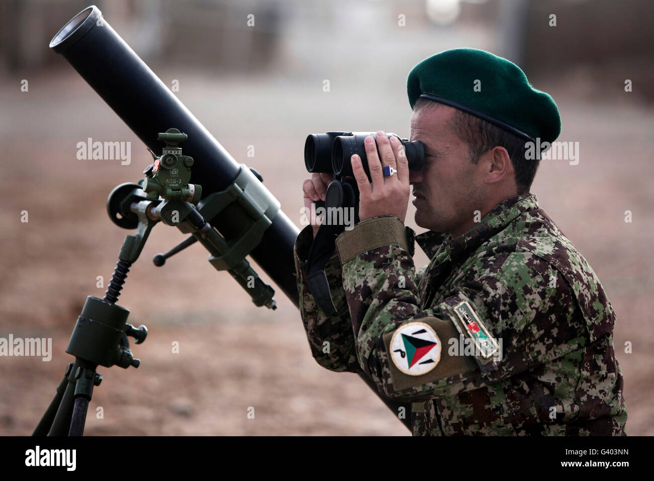 An Afghan National Army soldier trains to employ a mortar tube. - Stock Image