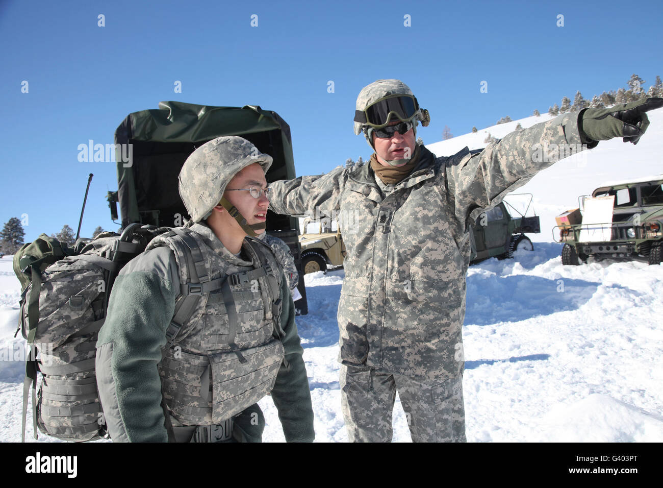 Army Specialist receives guidance as he begins a land navigation event. - Stock Image