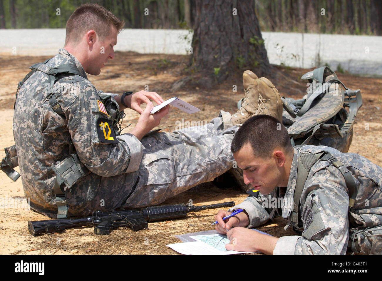 U.S. Army Rangers map out their route for day land navigation. - Stock Image