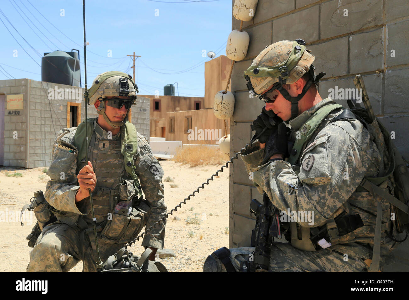 U.S. Army Soldiers use a radio to communicate. - Stock Image