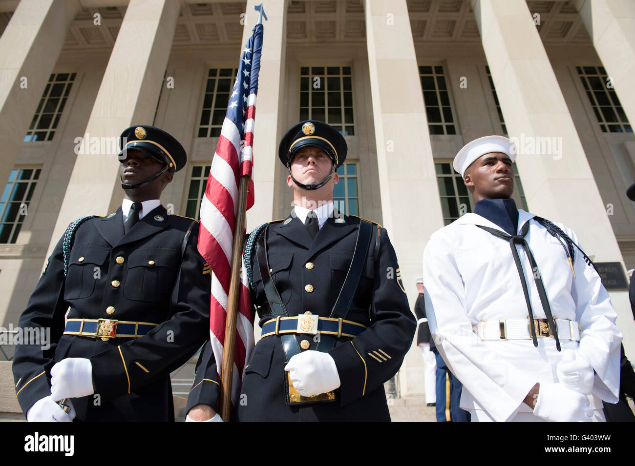 Members of the honor guard stand at attention in front of the Pentagon. - Stock Image