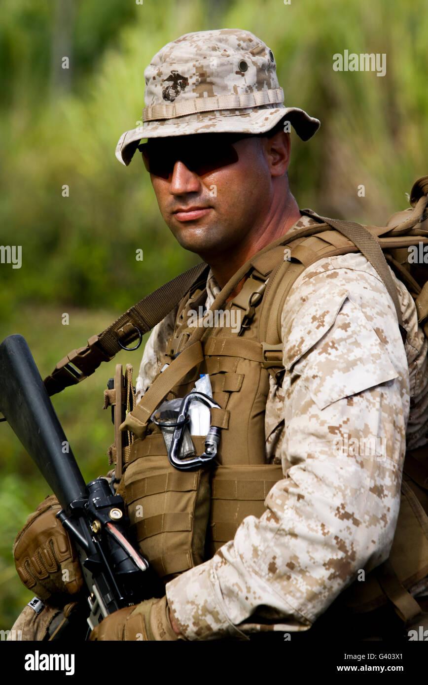 U.S. Marine waits to begin a patrol . - Stock Image