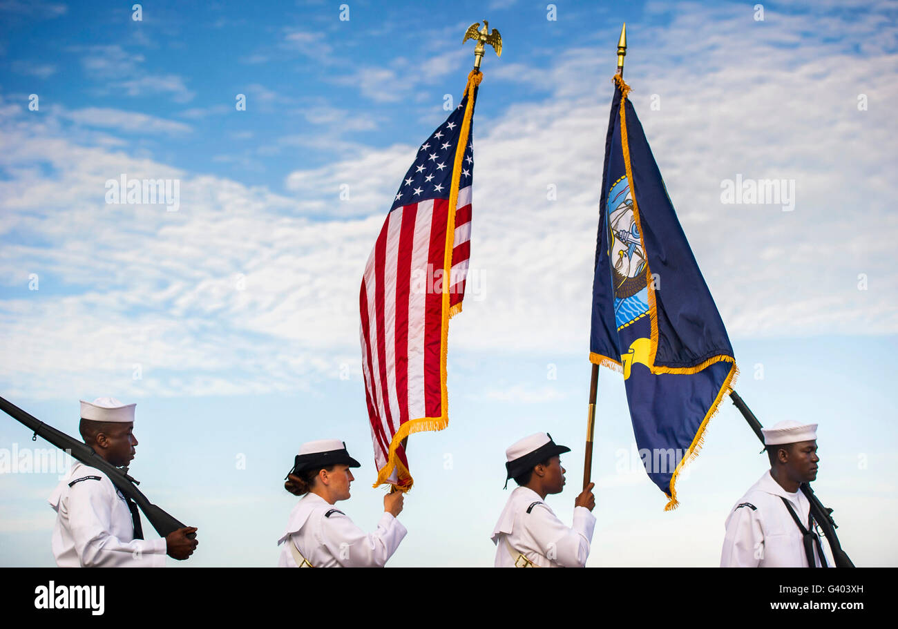 U.S. Navy members parade the colors at a remembrance ceremony. - Stock Image