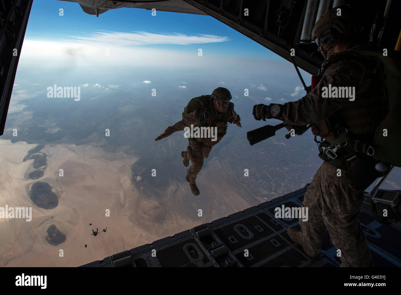 A U.S. Marines jumps from a HC-130 over Djibouti. - Stock Image