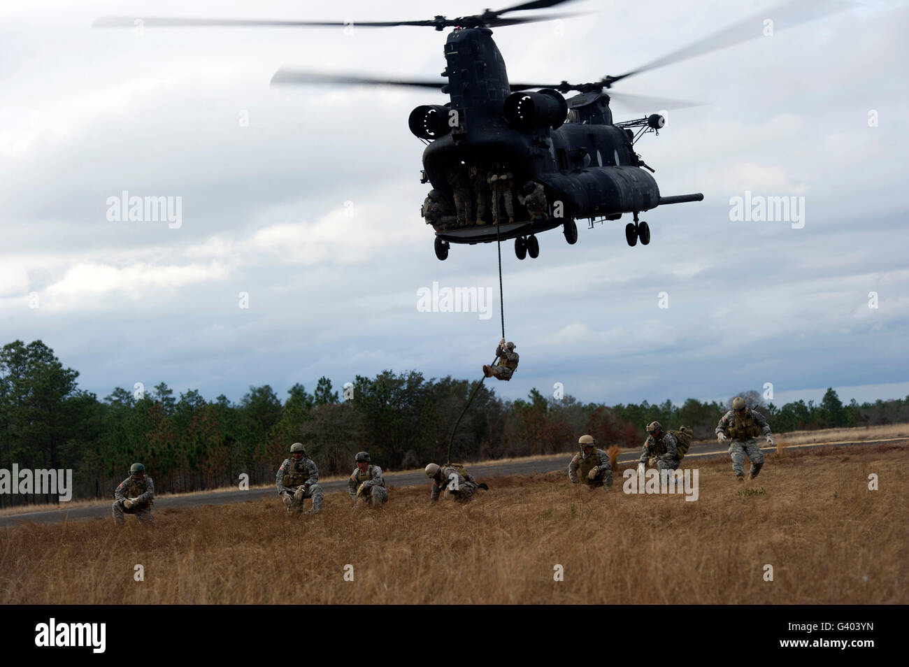 U.S. Soldiers with the 7th Special Forces Group fast rope out of a CH-47 Chinook. Stock Photo